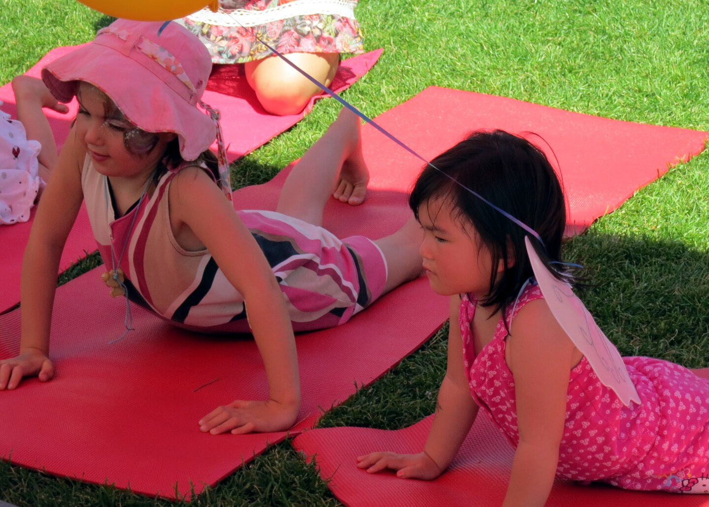 Children following yoga poses