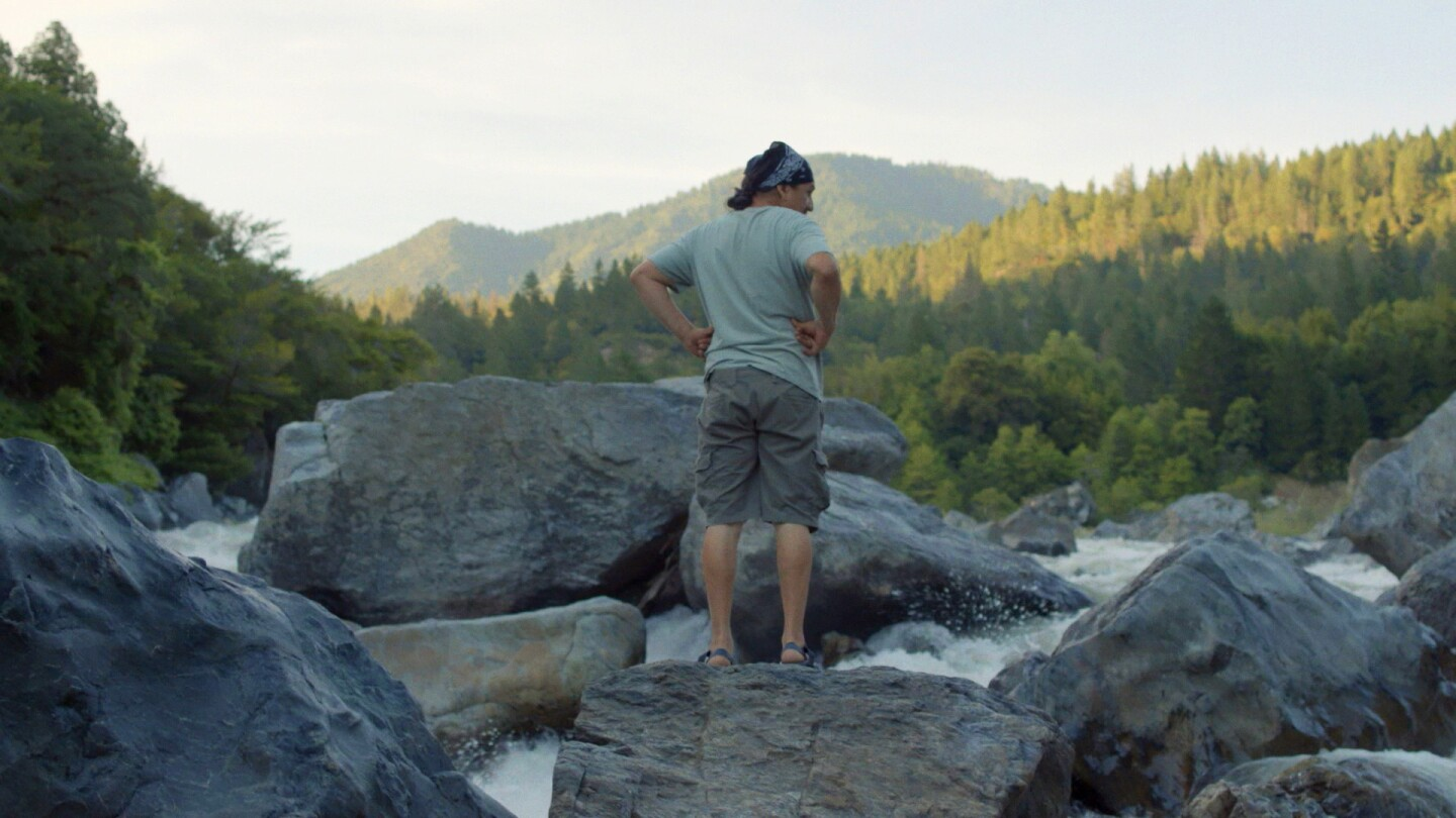 Yurok tribe member observing the river | Still from Tending Nature