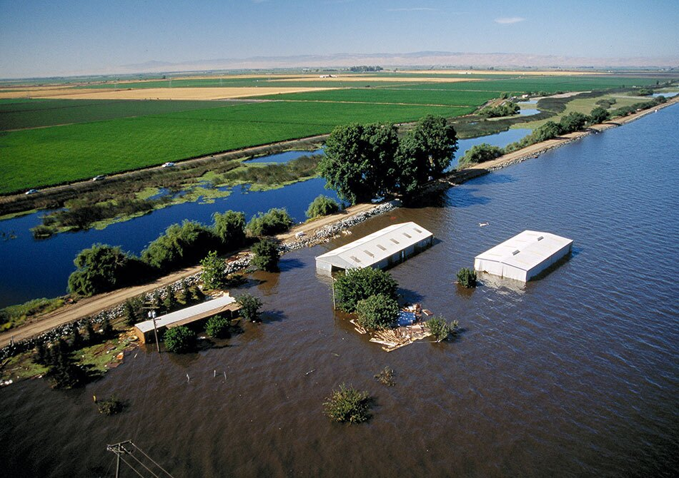 Heavily Flooded Properties with Farmland in the Background