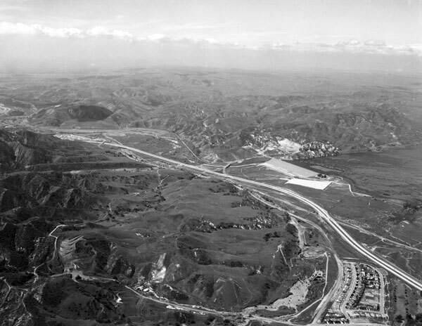 After the 1938 flood, local agencies built Prado Dam, visible on the center-right, just upstream from Santa Ana Canyon. Courtesy of the Orange County Archives.