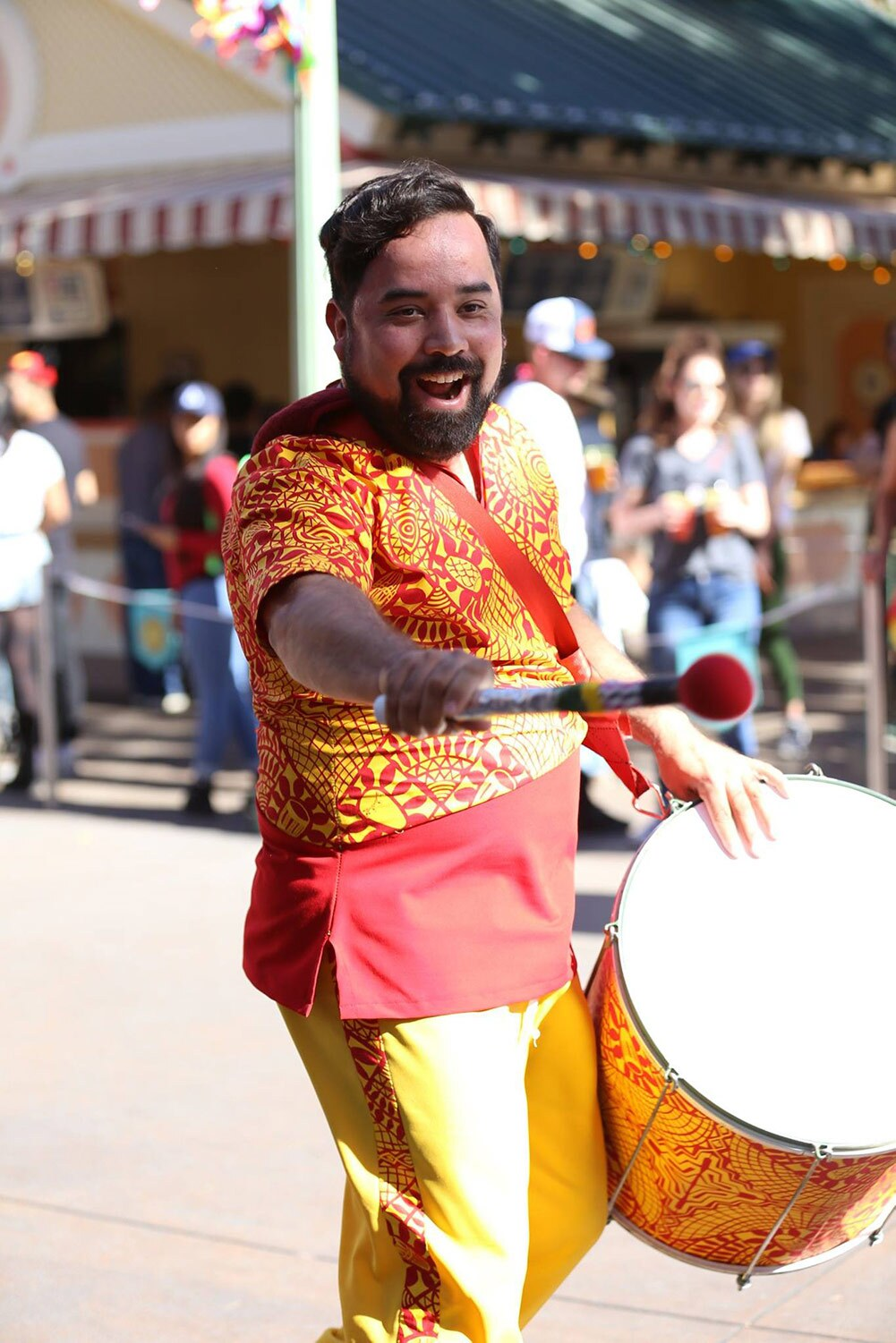 Drummer Steve Hernandez during Disney California Adventure Park's ¡Viva Navidad! Street Party parade | Courtesy of Viver Brasil