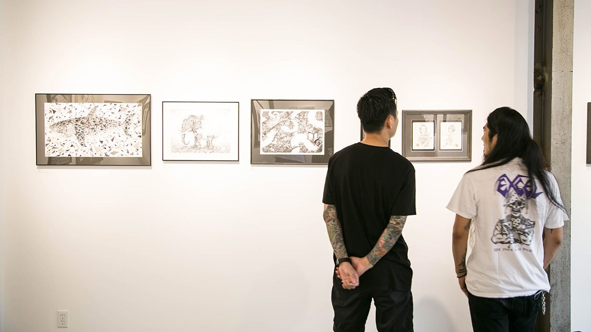 Two people look at art in a gallery | Flickr/OPC/Creative Commons/Public Domain
