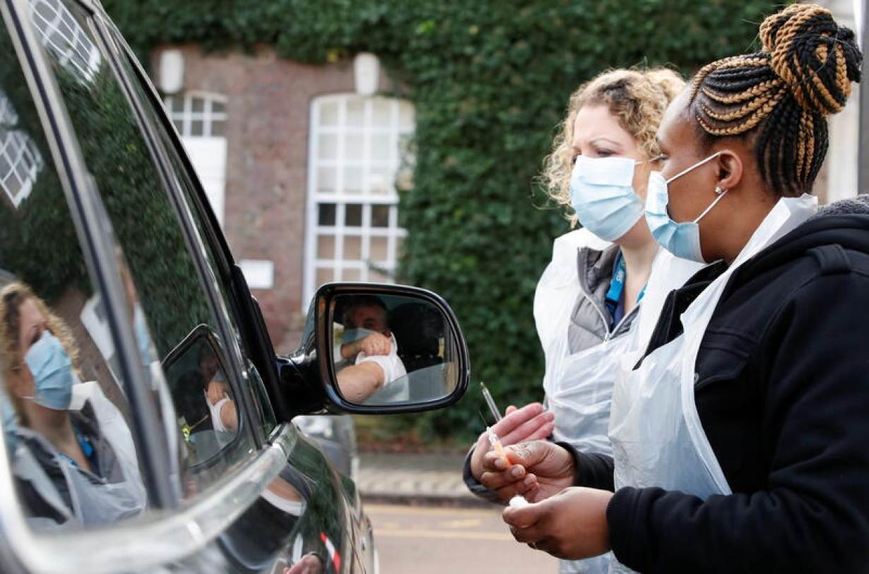 Health workers prepare to administer a COVID-19 vaccine at a drive-thru vaccination centre at Batchwood Hall, amid the outbreak of coronavirus disease (COVID-19) in St. Albans, Britain, February 5, 2021.