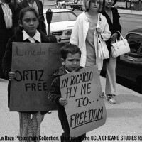 CSRC_LaRaza_B17F22S6_N007 Children carrying signs in support of Ricardo Chavez Ortiz in downtown Los Angeles   Pedro Arias, La Raza photograph collection. Courtesy of UCLA Chicano Studies Research Center