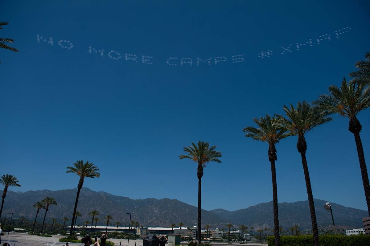"""""""NO MORE CAMPS #XMAP"""" written in in the sky, contributed by Tsuru for Solidarity and Karen L. Ishizuka over the Santa Anita Assembly Center 