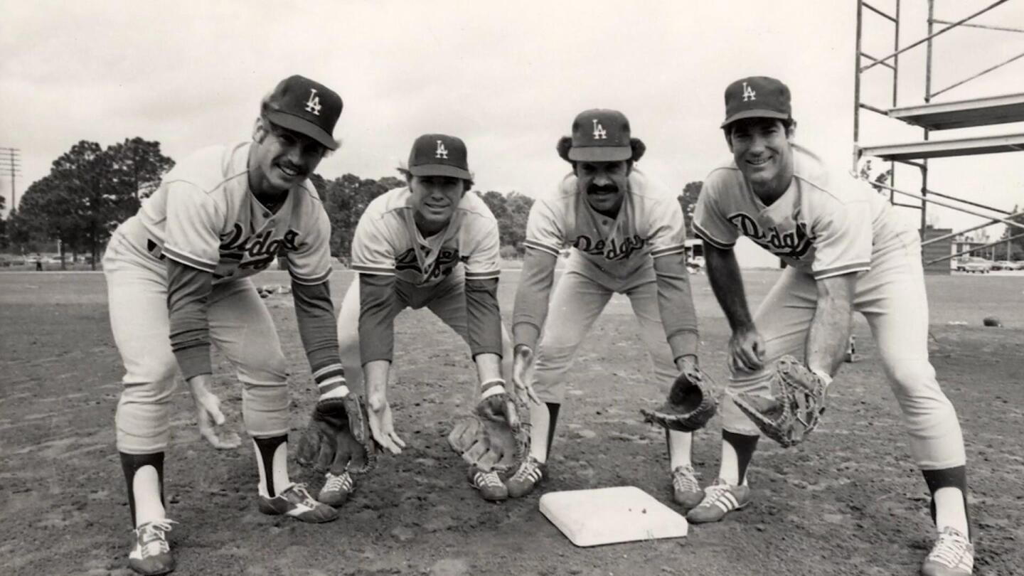 """Dodgers baseball players pose for a picture. 