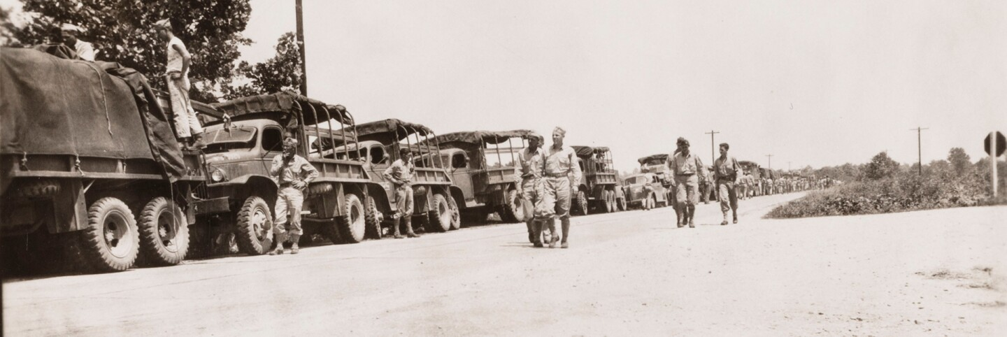 A photograph of an Army convoy, 1941 July 10| Go for Broke National Education Center Collection, USC Libraries
