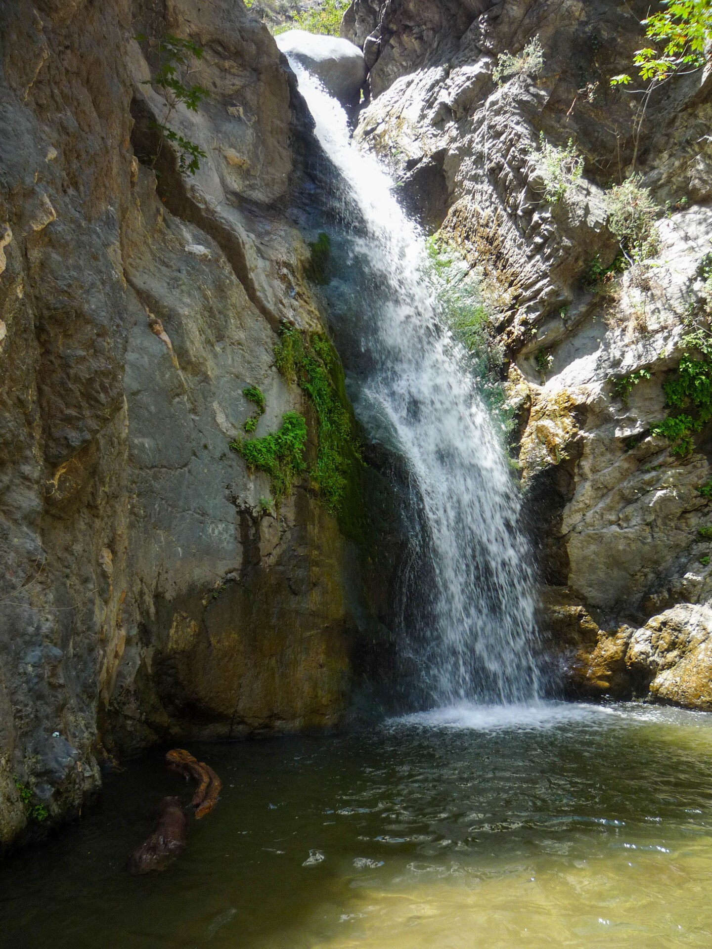 The waterfall at Eaton Canyon empties into a pool of water at the foot of the falls where hikers will frequently swim.