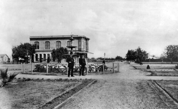 Another 1887 view of the plaza, showing two men who are often (but questionably) identified as Orange's founders, Alfred Chapman and Andrew Glassell. Courtesy of the USC Libraries - California Historical Society Collection.