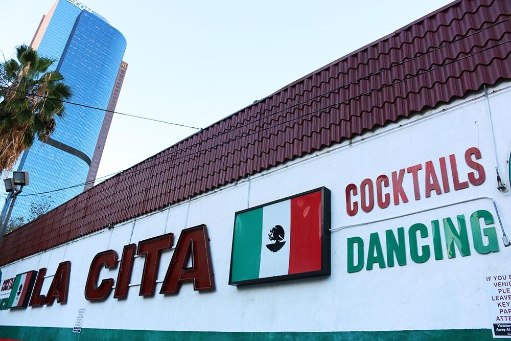 "La Cita Sign with LA skyscraper in the back: Mexican flag, "":Cocktails,"" ""Dancing"""