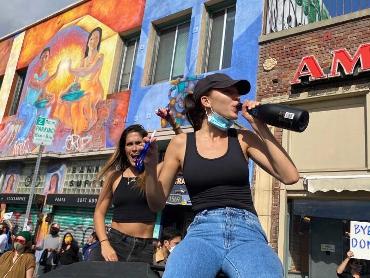 Revelers in Echo Park celebrate Joe Biden's electoral college win over President Donald Trump on Saturday, Nov. 7, 2020. | Gina Pollack/LAist