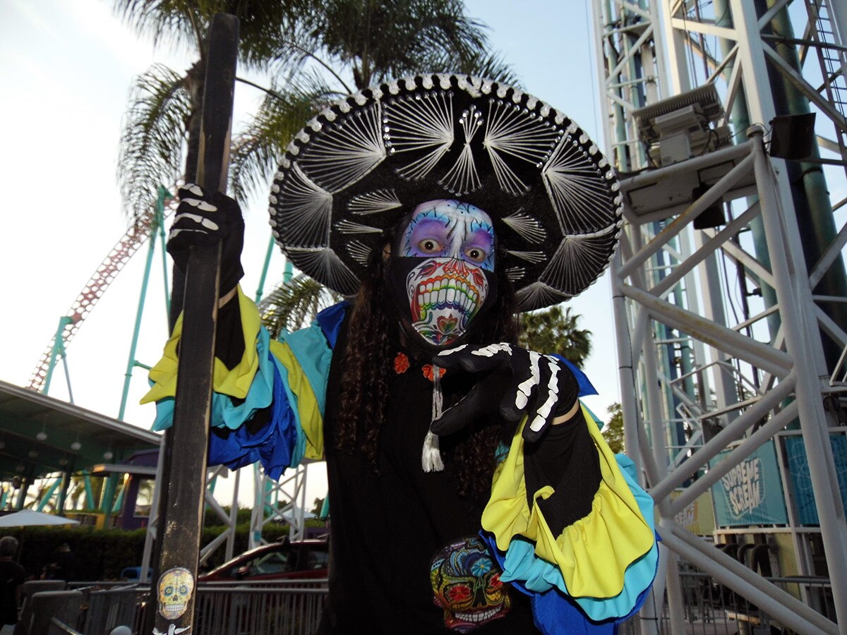 A stilt-walker poses at Knott's Taste of Fall-O-Ween. | Sandi Hemmerlein