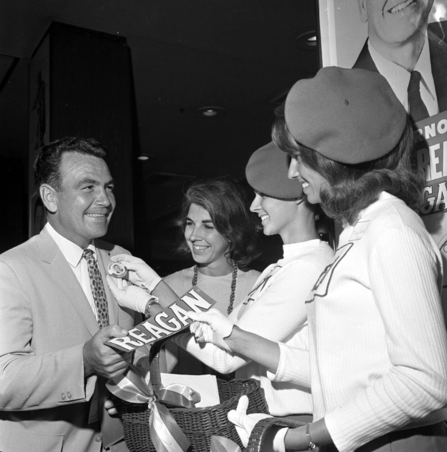 """Three """"Reagan girls"""" hand out campaign materials in 1966"""