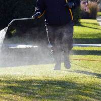 A pesticide applicator spraying a residential lawn | Photo: iStockPhoto