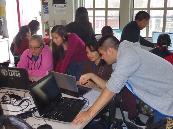 Foshay Tech Academy students collaborate with community members during the 2013 Hour of Code event.  photo by Leslie Aaronson