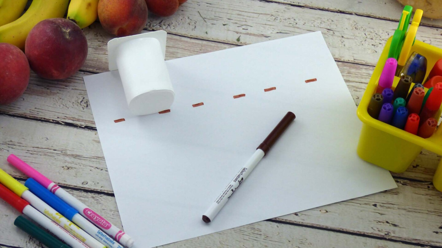 Measuring strips of paper for yogurt cups