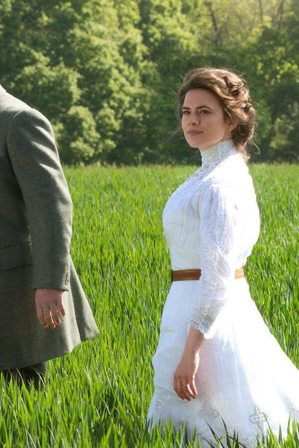"A man and woman walk in a verdant green meadow. | From a preview of ""Howards End"" on Masterpiece."