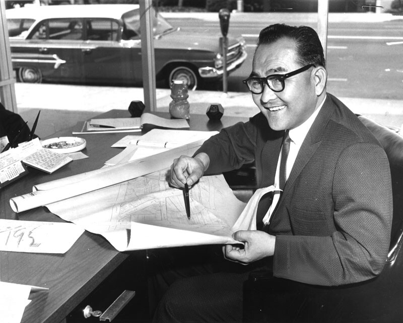 Bruce Kaji photographed in 1964 with a plan for Little Tokyo.