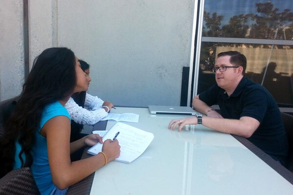 Two students interviewing Jeremy Bunting, Associate Technology Director at Deutsch