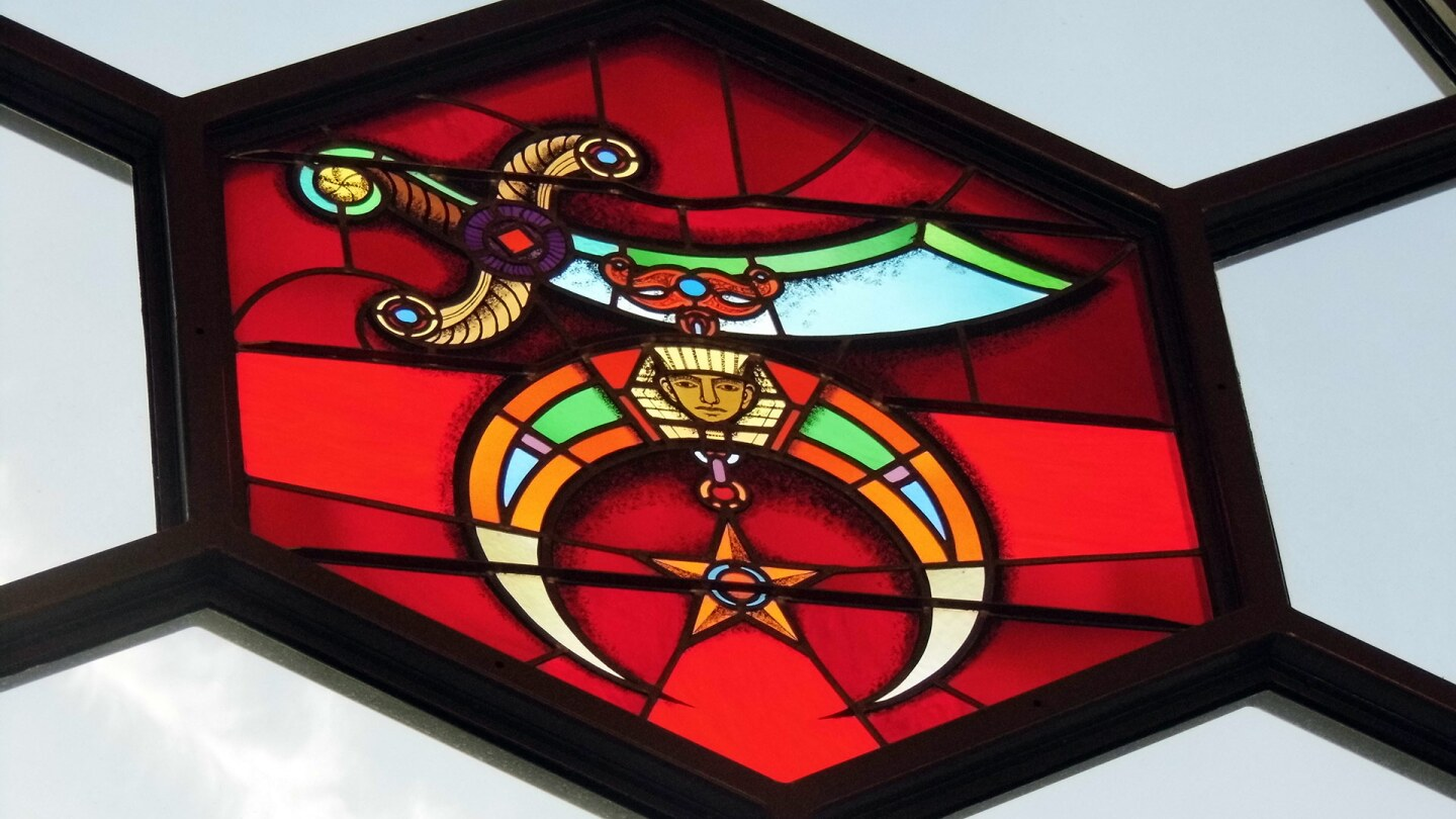 The Shriners emblem is a scimitar with a crescent made of two claws embellished with a sphinx head and a five-pointed star. | Sandi Hemmerlein