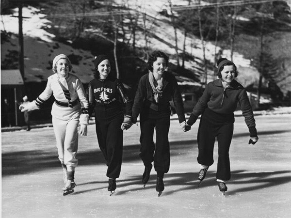 Female figure skaters on an ice rink at Big Pines mountain camp, ca.1930 | Digitally reproduced by the USC Digital Library; From the California Historical Society Collection at the University of Southern California