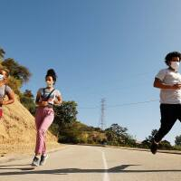 Joggers run in Runyon Canyon Park near the North entrance on Mulholland Drive in the Hollywood hills on May May 27, 2020 in Los Angeles, CA. | Al Seib/Los Angeles Times via Getty Images