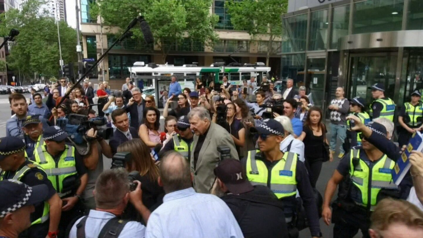 Reporters surround Cardinal Pell in a scene from Four Corners.