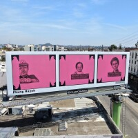"""Three pink squares on a billboard have three images drawn onto them. The one on the far left is a portrait of Chef Visoth Tarak Ouk, widely known as """"Chef T."""" He's wearing a T-shirt and a baseball cap proudly flashing a tattoo on his fingers that reads """"Chef Life."""" In the middle box is an unsmiling baby girl propped up by an adult hand, her name written on a mugshot letter board. On the right box is a man with his head tilted and the same surname as the baby girl."""