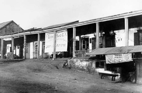 The Quon Sang Employment Office next to Sam Sing Butcher Shop in the Los Angeles Plaza, circa early 1900s.   Courtesy of the Los Angeles Public Library