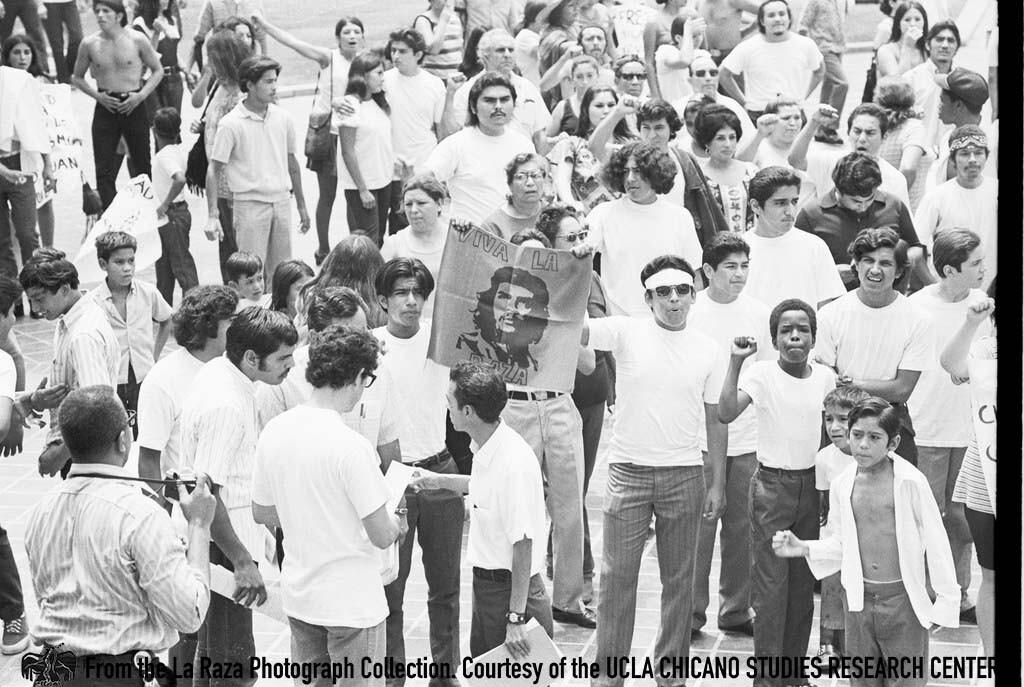 CSRC_LaRaza_B15F2C1_DZ_007 Protesters in la Marcha por los Tres in front of L.A. City Hall | Daniel Zapata, La Raza photograph collection. Courtesy of UCLA Chicano Studies Research Center