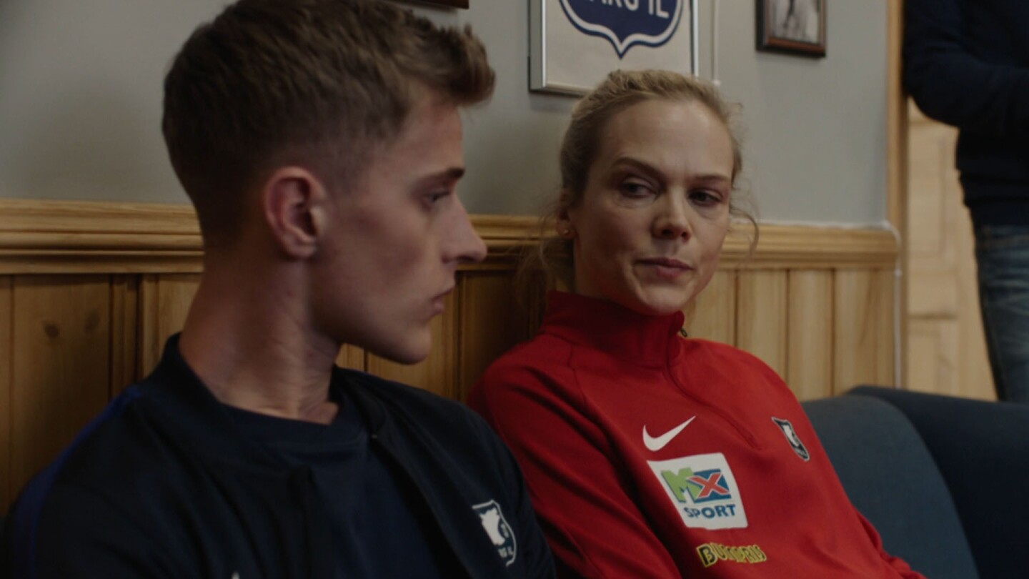 "Helena looks at the person sitting next to her. | Still from ""Home Ground: Everything for Norway"""