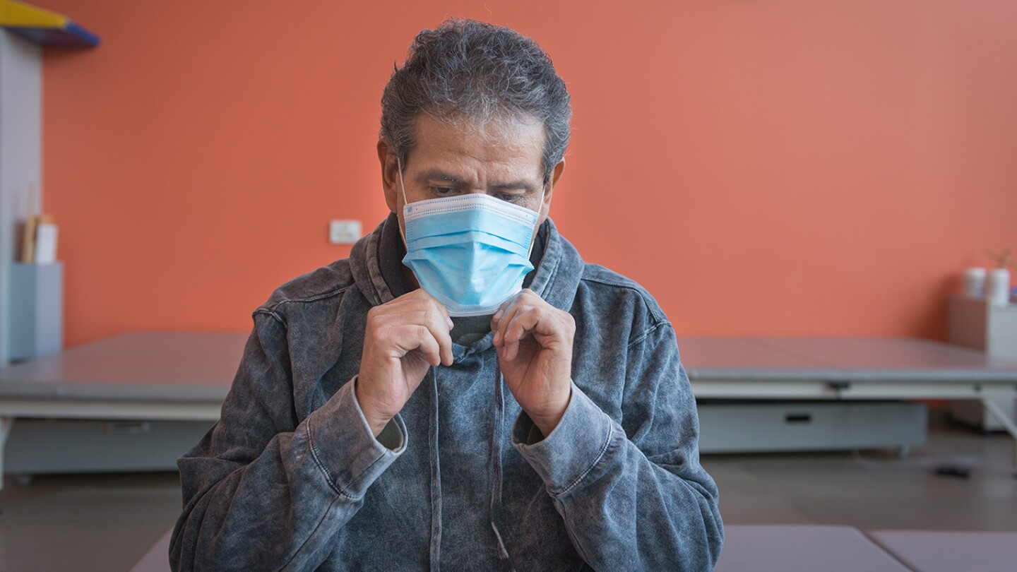 Perez takes a break during his therapy. He could barely breathe when he was admitted to Los Angeles County's Harbor-UCLA Medical Center in early June of last year.