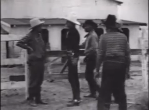 Herb Jeffries, second from left in white hat, greets Flurnoy Miller | Screen capture from The Bronze Buckaroo