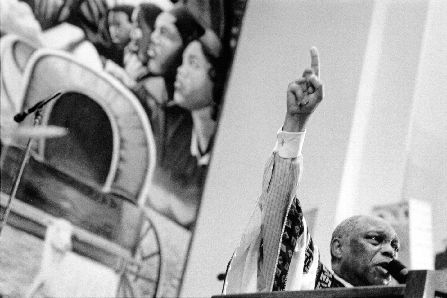 "Rev. Cecil ""Chip"" Murray pointing up to the sky. 