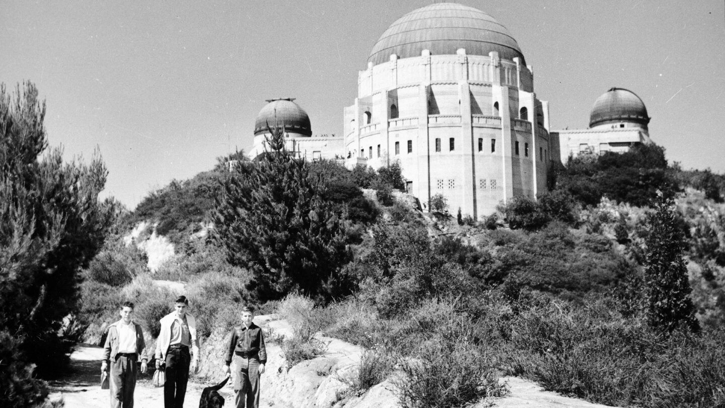 Young men walking with a view of Griffith Observatory | Courtesy of the California Historical Society Collection at the University of Southern California Library