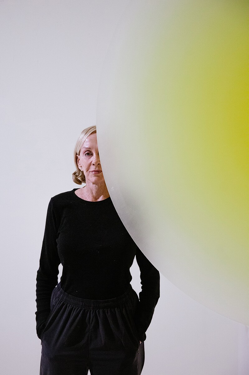 Helen Pashgian behind one of her light and space artworks | Alix Spence