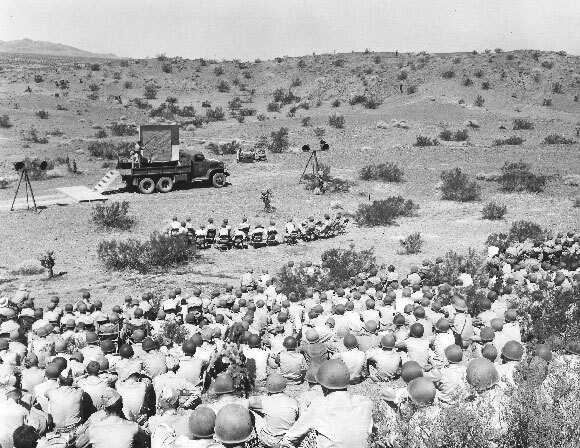 Officers listen to reviews of a maneuver held five miles from Needles, California at the Desert Training Center in September 1942. | U.S. Army photograph, courtesy of the General Patton Memorial Museum.