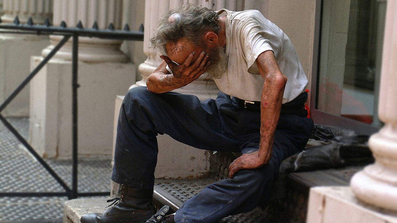 A homeless man sitting on a stoop   Ben Hershey / Unsplash
