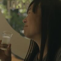 "Noriko Kamei enjoying sake | Still from ""The Migrant Kitchen"" Sequoia Sake"