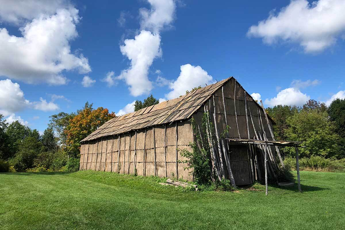 The longhouse at Ganondagan, the Seneca village in present-day Ontario County, New York, that the French burned to the ground during a fur-trade dispute in 1687. Today, is a historic site and cultural center. | Paige Bardolph