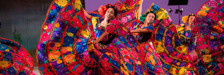 Ballet Folklórico de Los Ángeles dancers in vivid pink dresses dance Mexican ballet folklórico in Nochebuena at The Soraya accompanied by music from Mariachi Garibaldi de Jaime Cuéllar on Dec. 14, 2019. | Luis Luque