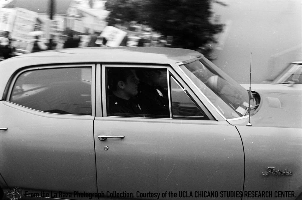 CSRC_LaRaza_B1F3C1_Staff_008 Men in a car during the Roosevelt High School walkouts | La Raza photograph collection. Courtesy of UCLA Chicano Studies Research Center