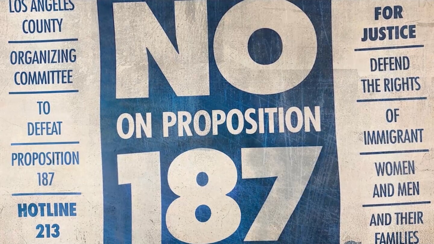 "A blue and white ""No to Proposition 187"" sign 