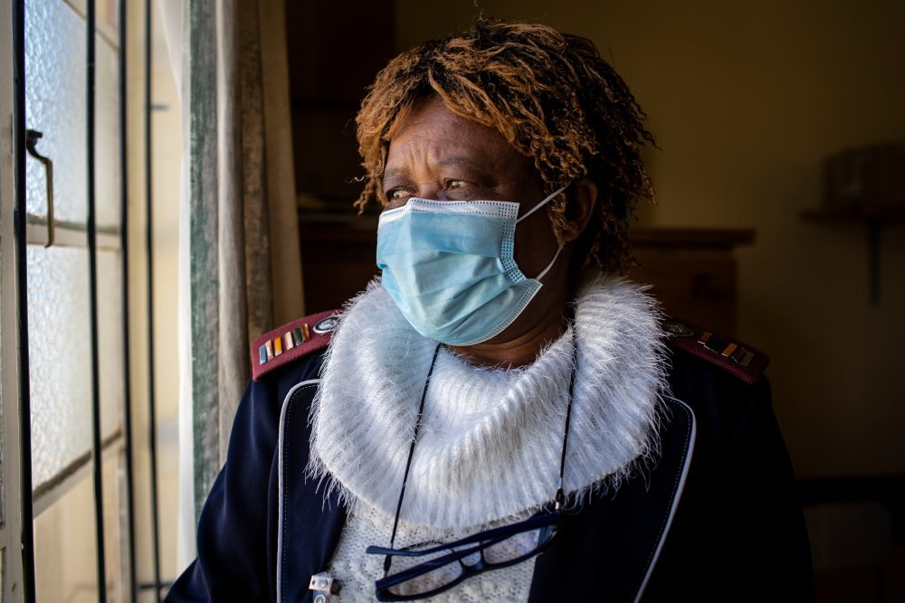 Nurse Ruth Seikaneng (64) sits for a portrait at the Reivilo Health Centre in Reivilo. hen her colleague died from COVID-19 she had to work even longer hours to support the town. Thomson Reuters Foundation/Gulshan Khan