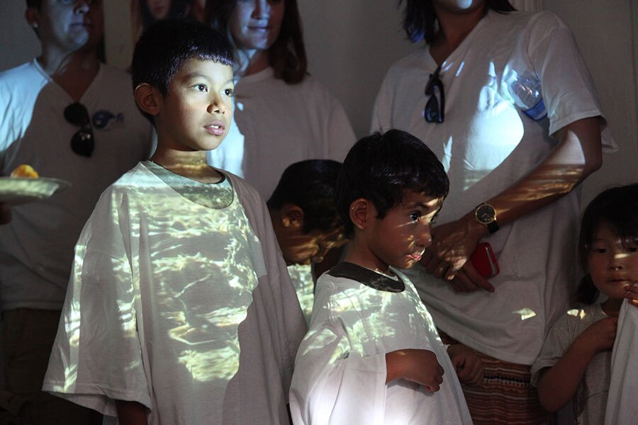 Kids' white shirts act as a backdrop for a video projection   Photo: Drew Tewksbury