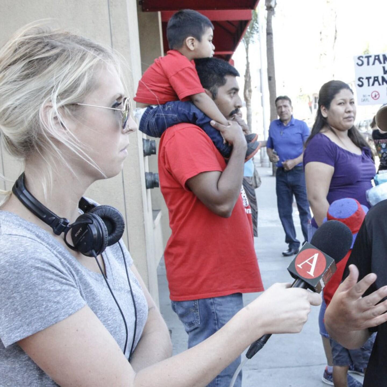 Marie Targonski-O'Brien reporting at a protest in Santa Ana, Calif.