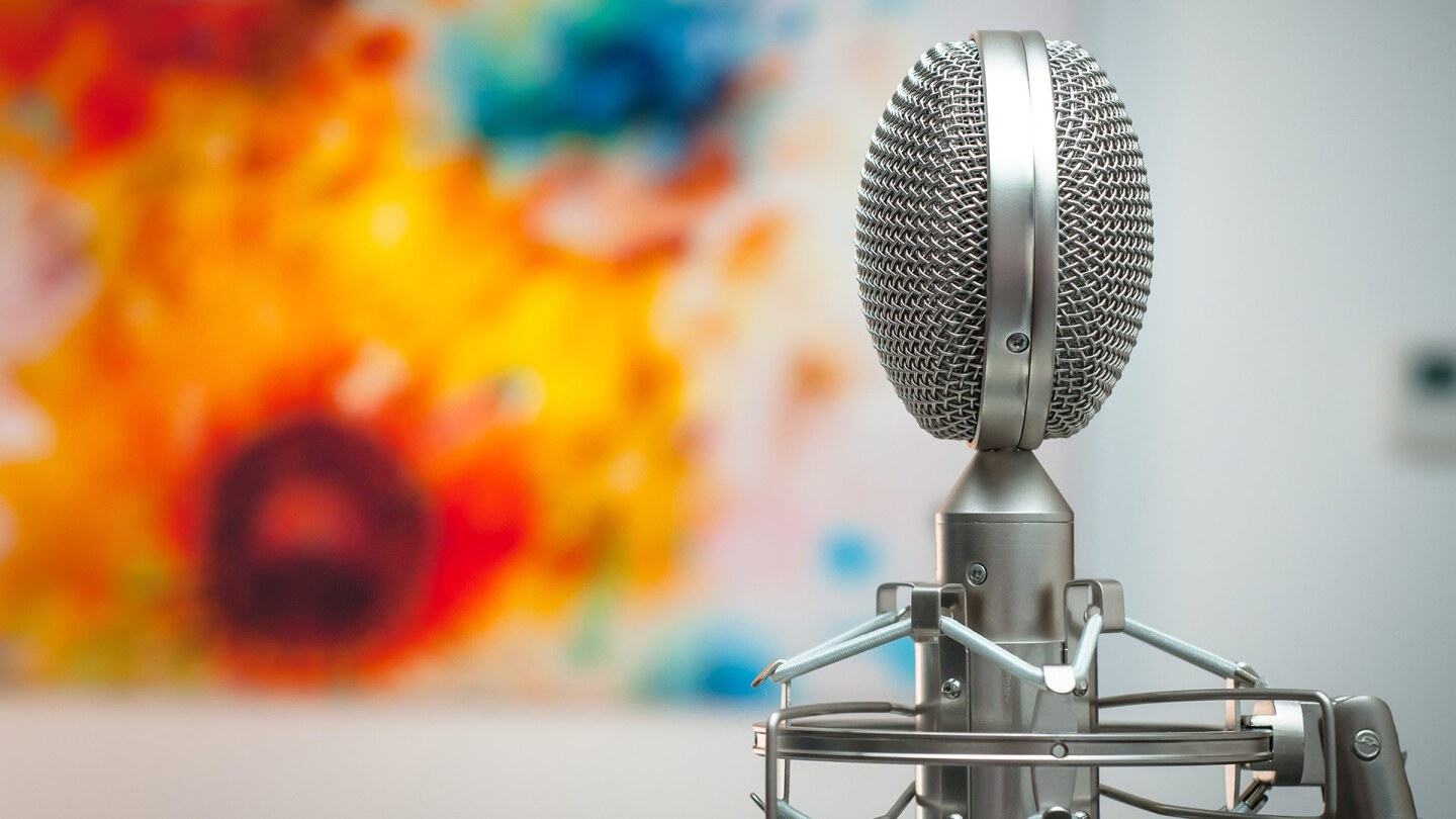 Gray microphone with a colorful art background   Michal Czyz / Unsplash