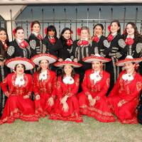 Mariachi Divas de Cindy Shea (top row), Leonor Xochitl Perez, Ph.D. (top row, sixth, clockwise) and Las Adelitas (bottom row, in red) in London at the International Mariachi Women's Festival, July 21, 2018. | Eddie Sakaki Photographer