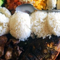Kamayan dining with grilled fish, fried shrimp, eggplant, grilled squid and rice | Pampanguena Cuisine