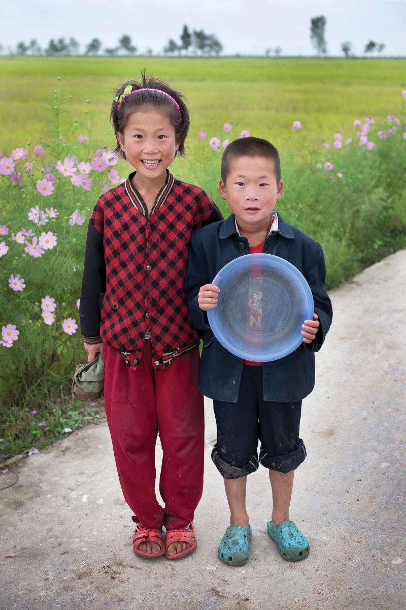 Two children at a communal farm in Kangwon Province, North Korea   Mark Edward Harris